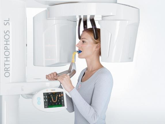 Woman using 3-D Cone Beam Computerized Tomography (CBCT)